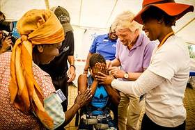 Richard Branson at Bhubezi Healthcare clinic in South Africa