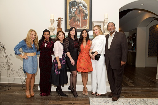 The Team of In A Perfect World (L-R) Lani Evans, Kelsey Dominick, Diana Villarreal, Christine Onesky, Manuela Testolini, Michelle Vink and Norman Bailey pose for the team photo at the In A Perfect World 10 Year Celebration Of Giving