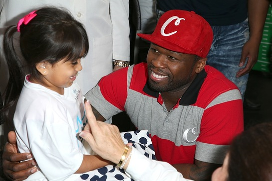 50 Cent attends to patient Isabella at the Starkey Hearing Foundation hearing mission during Super Bowl weekend 2016