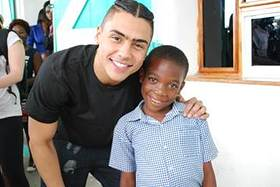 Quincy Brown with Smile Train patient in Cap Haitien, Haiti.