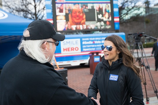 Air Force veteran Randall Murray, left, talks with Danica Patrick at the Aspen Dental MouthMobile as part of the Healthy Mouth Movement 2016 launch