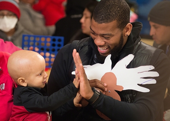 Greg Monroe of the Milwaukee Bucks shares a special moment with St. Jude patient Colton during a recent team visit to St. Jude Children's Research Hospital