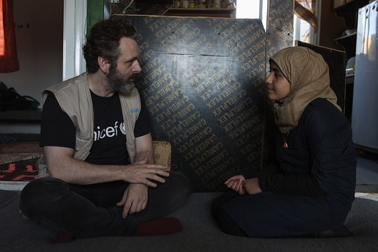 Michael Sheen talking to 13-year-old Omaymah, who has been campaigning for girls' education.