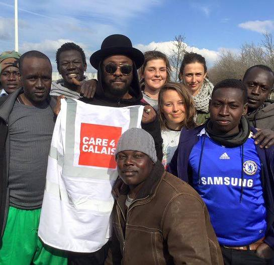 will.i.am visits refugees at Calais refugee camp