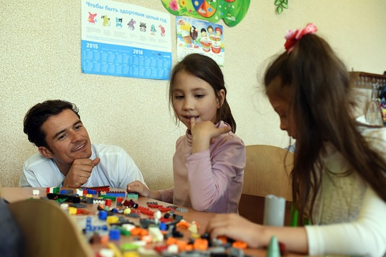 Orlando Bloom plays lego with pupils of School #13 in Slovyansk, as part of a visit to conflict-hit eastern Ukraine.