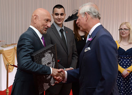 Sir Ben Kingsley presents HRH with a Digital Book of Memories