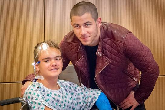 Nick Joans Meets A Patient At Children's Hospital of Orange County
