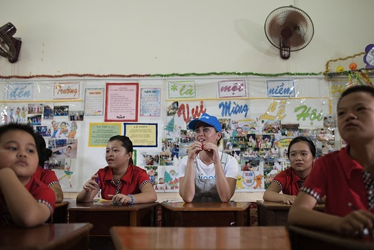 Katy Perry sits with students during a lesson at the Quang Son Daycare Center in Ninh Thuan Province.