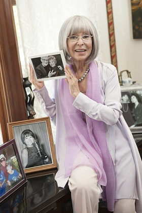 Rita Moreno poses with a photo of her late husband, Leonard Gordon