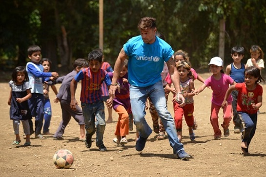 Ricky Martin plays football with Syrian refugee children at Al-Hissa informal refugee settlement in northern Lebanon