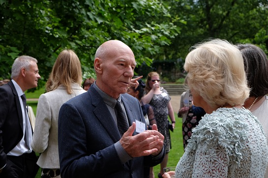 The Duchess meets Sir Patrick Stewart at a reception she hosted at Clarence House for domestic abuse survivors and campaigners