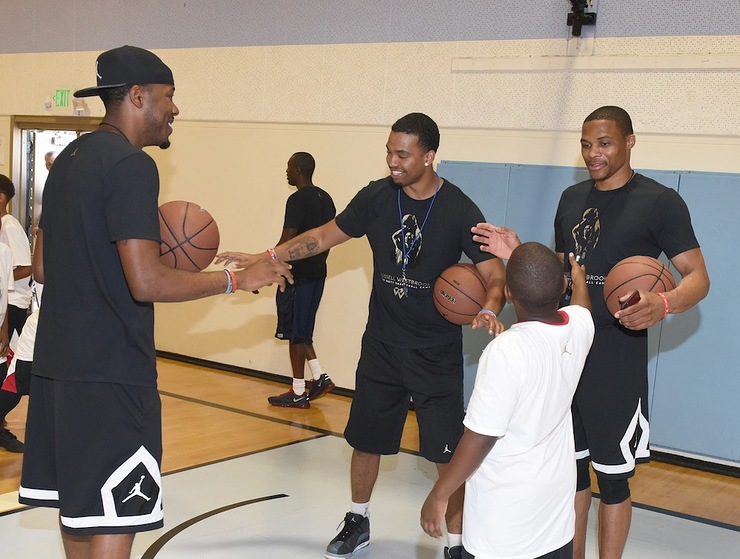 Russell Westbrook teaches kids at the Russell Westbrook Why Not? Basketball Camp at Jesse Owens Community Regional Park