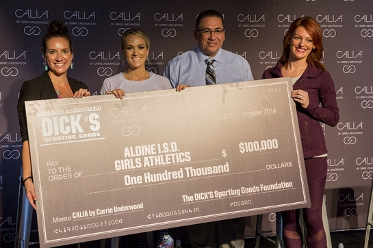 CALIA by Carrie Underwood in partnership with The DICK'S Sporting Goods Foundation's Sports Matter program surprises unsuspecting athletes and coaches of the Aldine Independent School District with a $100,000 check donation