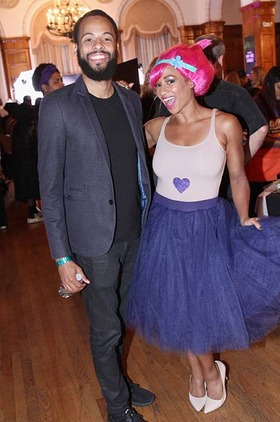 After visiting the crafting fun house hosted by title sponsor Michaels Stores, Monique Coleman can't stop the feeling as a cheerful Troll with husband Walter Jordan at Dream Halloween