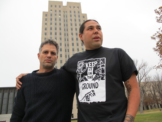 Actor-activist Mark Ruffalo poses with Dallas Goldtooth, of the Indigenous Environmental Network, outside the state Capitol in Bismarck, N.D., Tuesday, Oct. 25, 2016.