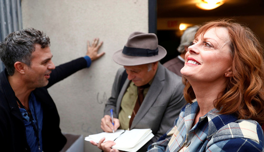 Susan Sarandon and Mark Ruffalo speak with author Greg Palast backstage at a climate change rally at MacArthur Park in Los Angeles, California, October 23, 2016.