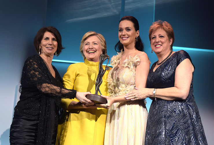 Pamela Fiori, Hillary Clinton, Katy Perry, and Caryl Stern speak on stage during the 12th annual UNICEF Snowflake Ball