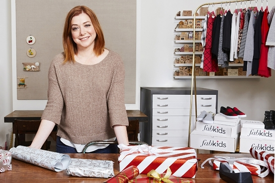 Alyson Hannigan and family graciously turned their home into Santa's workshop to package FabKids shirts, pants, dresses, hats, and accessories