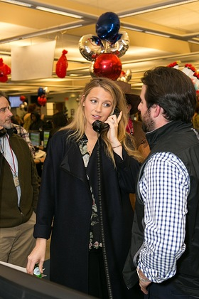 As part of the 24th annual ICAP Charity Day, Blake Lively fields phone calls on the firm's Jersey City trading floor