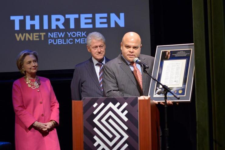 Maya Angelou's grandson Colin Johnson presents Secretary Hillary Clinton and President Bill Clinton with a plaque of her inauguration poem
