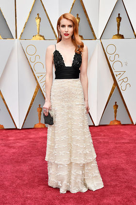 Emma Roberts wears a classic Giorgio Armani gown from his very first Prive' collection