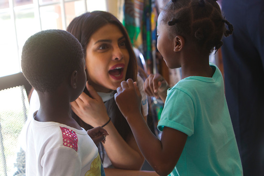 Priyanka Chopra speaks with child survivors of sexual violence at the Family Support Clinic in Chitungwiza town north of Harare, Zimbabwe