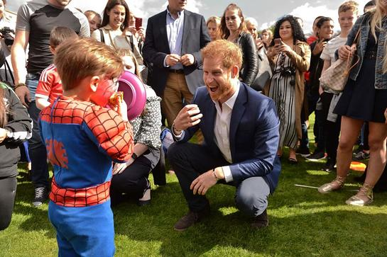 Prince Harry Meets Kids At Royal Party