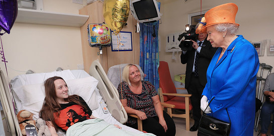 The Queen speaks to Millie Robson, aged 15, from County Durham, and her mum, Marie at Royal Manchester Children's Hospital