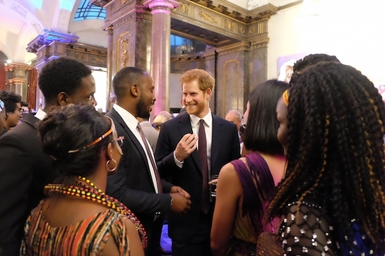Prince Harry joined Her Majesty at Buckingham Palace as The Commonwealth's young leaders were presented with medals for their service to their community