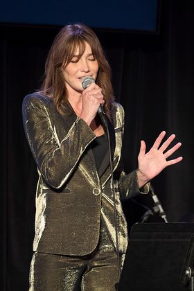 Carla Bruni Parforms at amfAR Event