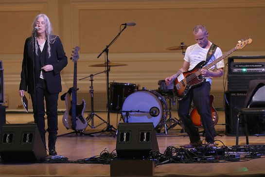 Patti Smith and Flea perform on stage during Pathway To Paris Concert For Climate Action at Carnegie Hall