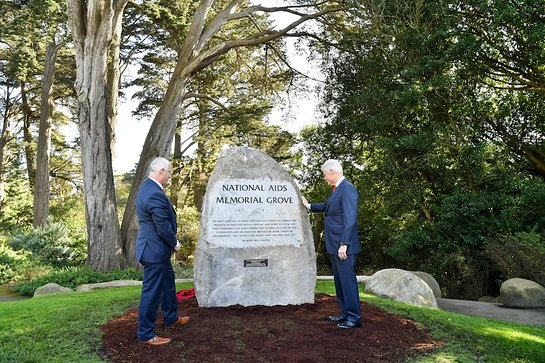 The National AIDS Memorial dedicates a boulder in honor of President Bill Clinton during World AIDS Day observances in San Francisco.