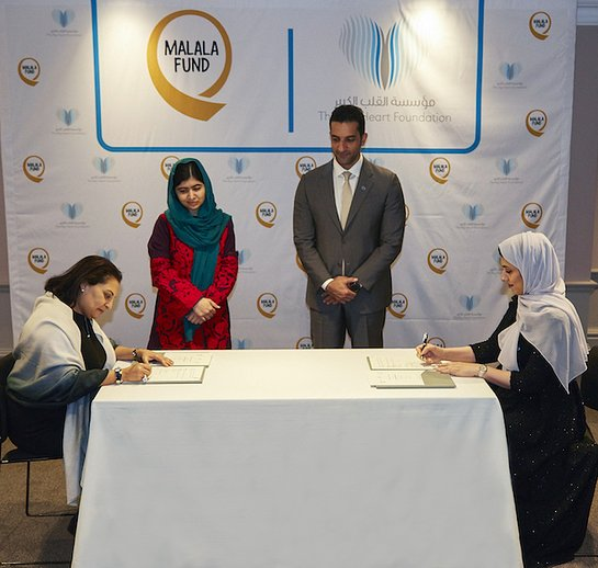Sheikh Sultan bin Ahmed Al Qasimi and Malala Yousafzai witnessing the signing between TBHF and Malala Fund