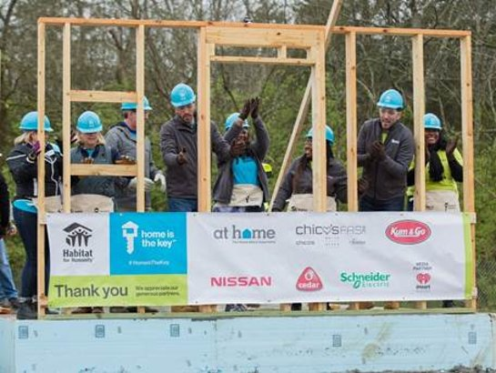 Drew and Jonathan Scott help future homeowners Ashlee and Amanda raise the walls of their new homes in Nashville