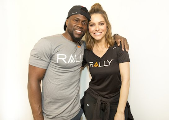 Rally Health Ambassadors Kevin Hart and Maria Menounos are all smiles in Chicago after joining gymgoers in their morning workout