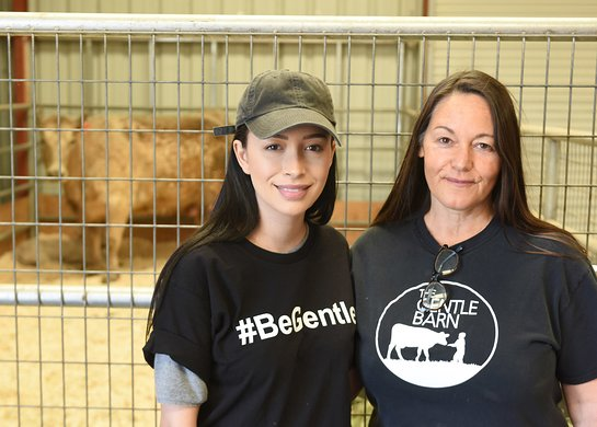 Christian Serratos and Founder of The Gentle Barn Foundation Ellie Laks greet a cow and her calf rescued from slaughterhouse at The Gentle Barn