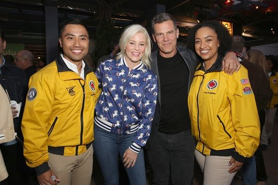 Elizabeth Banks (L) and Josh Brolin with City Year AmeriCorps members