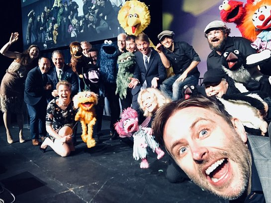 Host Chris Hardwick takes a selfie with the cast of Puppets for Puppetry