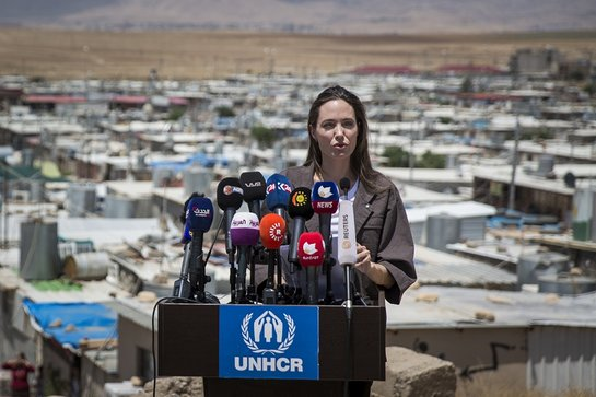 Angelina Jolie speaking to journalists at Domiz refugee camp in Iraq