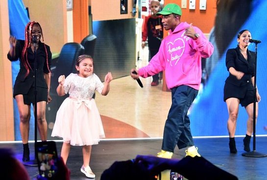 Pharrell Williams performs onstage with CHLA patient Eliana Georges