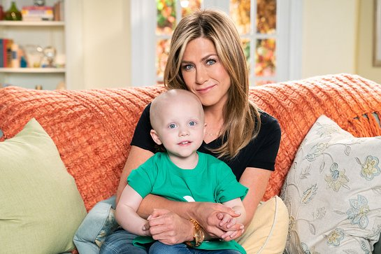 Jennifer Aniston smiles alongside St. Jude Children's Research Hospital patient Hadley