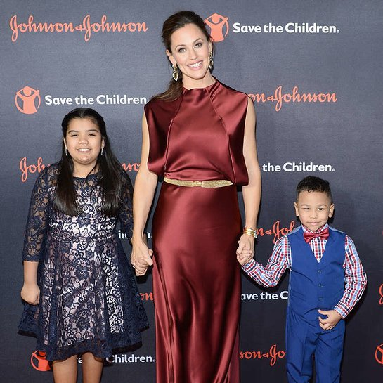 Save the Children program participants Sophia and Jakob pose for a photo with Jennifer Garner
