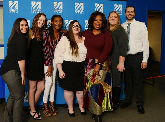 Oprah Winfrey poses with the first six UMass Lowell Oprah Winfrey Scholarship winners.