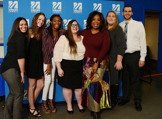Oprah Winfrey poses with the first six UMass Lowell Oprah Winfrey Scholarship winners.