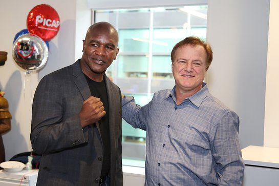 Evander Holyfield raising money for Heart 9/11 and FCI Academy FDN during the Annual ICAP Charity Day