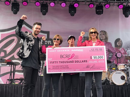 Andy Grammer Marc Cannon and Alice Jackson present a check for $50,000 to Myra Biblowit and Kinga Lampert,