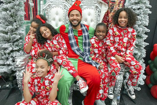 Jussie Smollett Surprises Kids at Holiday Event in Flint, Michigan