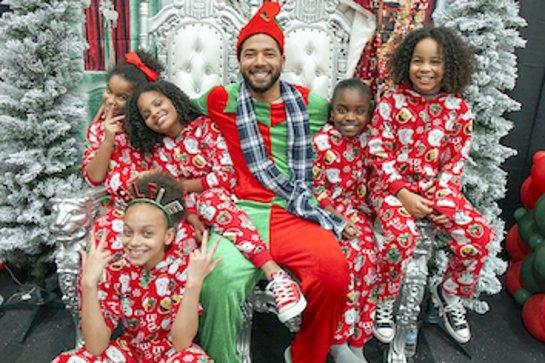 Jussie Smollett Surprises Kids at Holiday Event in Flint, Michigan