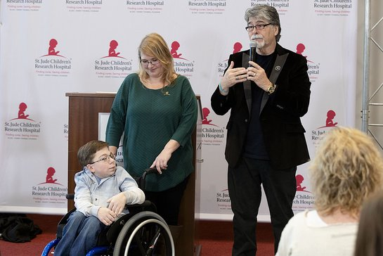 St. Jude patient Caleb and his mother Kelly help honor musician Randy Owen