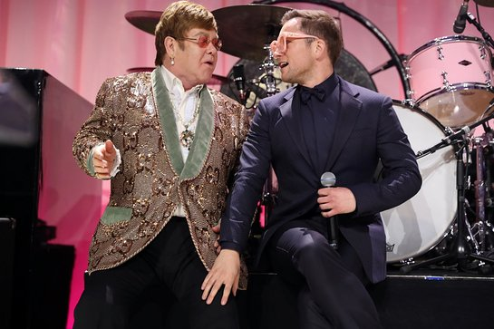 Elton John and Taron Egerton perform onstage during the 27th annual Elton John AIDS Foundation Academy Awards Viewing Party